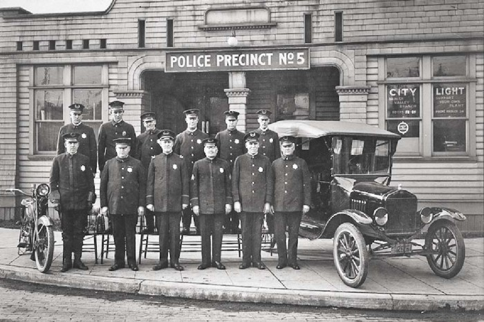 Times have changed. The Seattle Police Department's 5th precinct in 1921, when their fanciest piece of equipment was a Model-T Ford. (Photo from Seattle Municipal Archives)