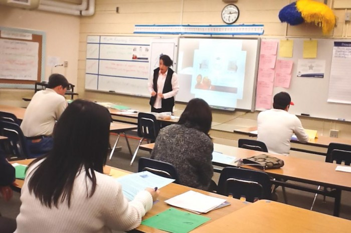 Mai Tran teaching a PASA class to parents at Meridian Middle School. (Photo Courtesy Millicent Borishade)