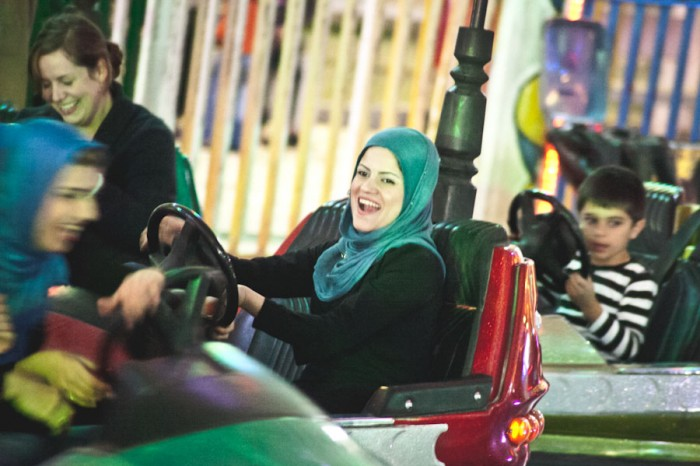 A ride on bumper cars at a late night amusement park in Sulaimaniyah, the second largest city in the Kurdish region of Iraq. Since 2003 the area enjoyed relative stability and economic success as compared to the rest of Iraq, but is now threatened by the expansion of the Islamic State. (Photo by Alex Stonehill)
