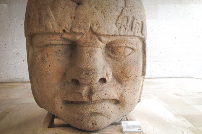 Olmec heads, on display at the Anthropology Museum in Veracruz, are often referenced as evidence of a pre-Columbian connection between Africa and Mexico because of their African features, but most anthropologists dismiss the connection. (Photo by Reagan Jackson)