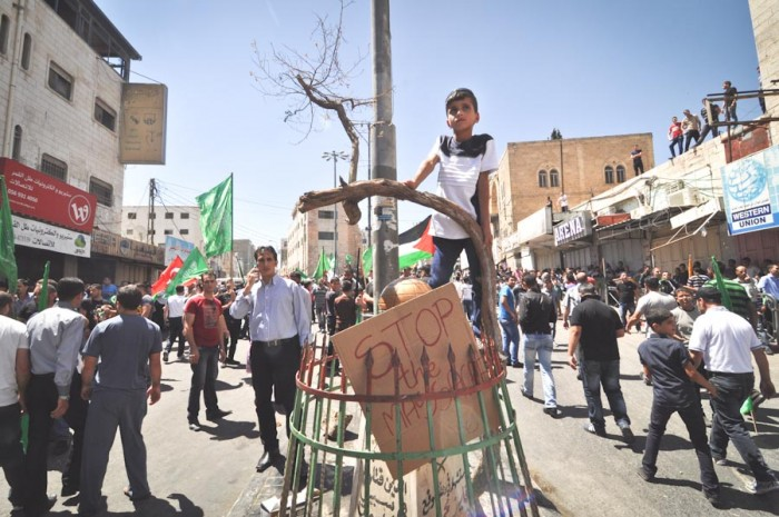 A young Palestinian from Hebron at a protest against Israeli military action in Gaza in early August. (Photo by Thomas James)