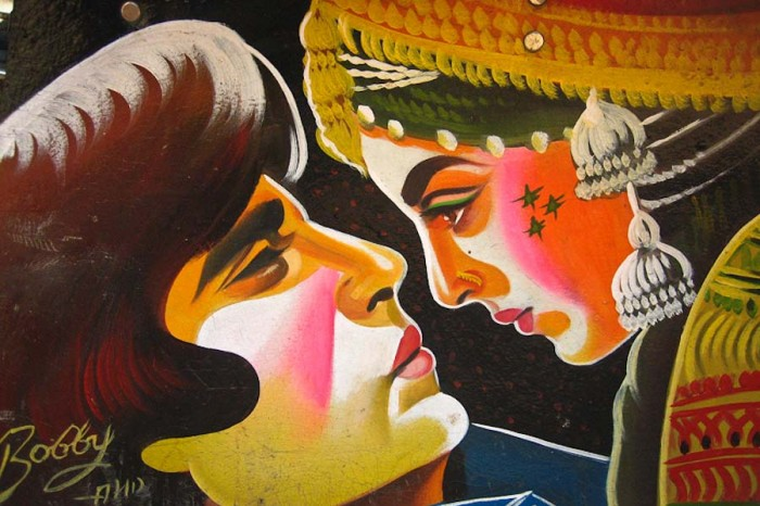 A rickshaw painted by Bobby Solanki depicts a classic Bollywood scene featuring Amitabh Buchchan and Rekha. (Photo from Flickr by Meena Kadri)