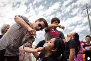 Protestors mimic force-feeding detainees at an August 2nd demonstration at the Northwest Detention Center in Tacoma. (Photo from NWDC Resistance Facebook Page )