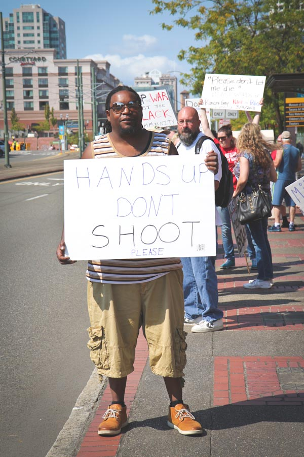 """We have to stop the police brutality. You just can't kill anybody, period,"" said Marcus Mitchell, standing in front of the United States Wester Washington District Court on Saturday. (Photo by Lael Henterly)"
