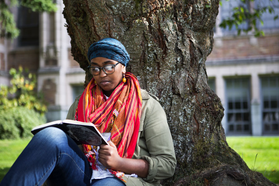 Hamda Yusuf, a third-year international studies major who is Somali American, often works on her poetry about identity at the Quad on the University of Washington campus. (Photo by Lindsey Wasson / The Seattle Times)