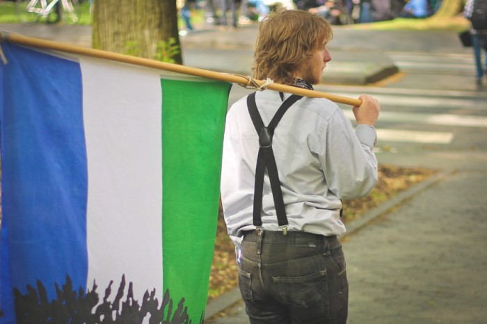 "Flying the Cascadia ""Doug Flag"" at Portland May Day celebration in 2012. (Photo from Flicrk by badlyricpolice)"