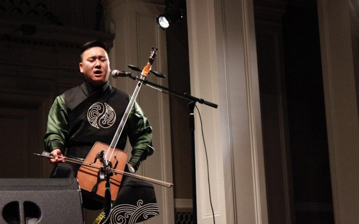 Horse head fiddle player and throat singer Davaazorig Altangerel performs as part of Mongolian orchestra Agra Bileg at Town Hall last Friday. (Photo by Aida Solomon)