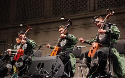 Three members of Agra Bileg playing the horse head fiddle. (Photo by Aida Solomon)