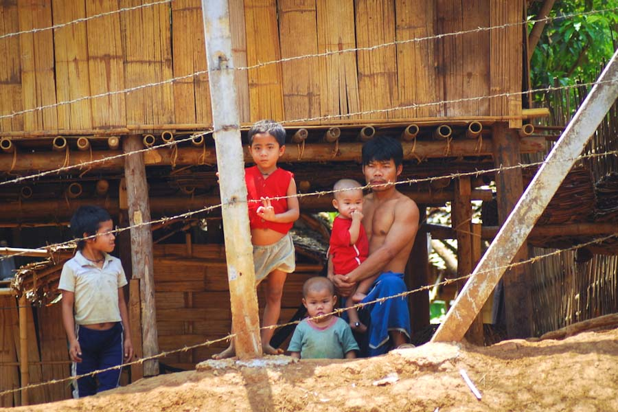 A family at a refugee camp in Thailand, where there are still 150,000 UN-recognized refugees unable to return home to Burma. (Photo by Mikhail Esteves)
