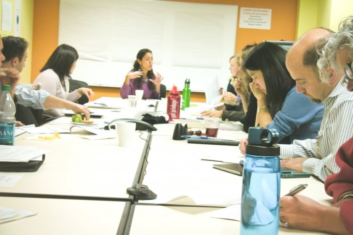 The Road Map Project English language learner working group planning for the Para-educators teacher pipeline pilot project. The author is at center. (Photo courtesy OneAmerica)