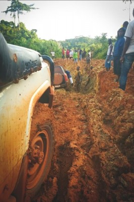 Conditions on Liberia's national highway makes dealing with Ebola in remote areas nearly impossible. (Photo by Karin Huster)
