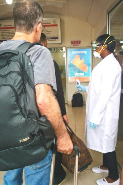One of many checkpoints around Liberia (this one at the Monrovia airport) where everyone is checked for symptoms of Ebola — sometimes with faulty equipment. (Photo by Karin Huster)