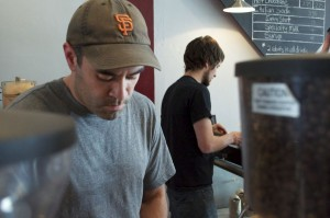 Carlos Salmeron (left) prepares an espresso drink at his new coffee house, Ventoux Roasters, in Bryant, Seattle. (Photo by Janelle Retka)