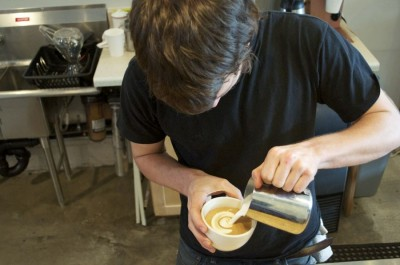 Matt Ehresman, owner of Hart Coffee Roastery, prepares a latte at the new Bryant coffee house. (Photo by Janelle Retka)