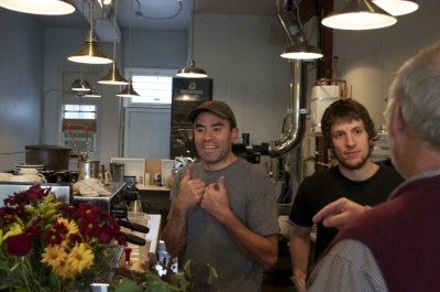 Carlos Salmeron (left), owner of Ventoux Roasters, and Matt Ehresman, owner of Hart Coffee Roastery, welcome customers to their new, shared coffee space. (Photo by Janelle Retka)