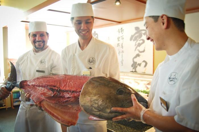Shiro's sushi chefs Aaron Pate, Jun Takai, Tsuyoshi Kobayashi (left to right) pose with a 75 pound egg-raised bluefin tuna after Takai butchered it. (Photo by Ana Sofia Knauf)