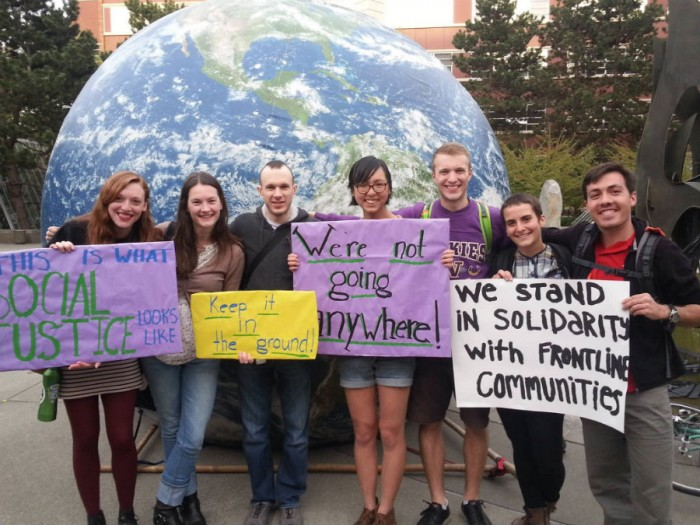 Divest UW students, including Alex Lenferna (rightmost), accompany divestment activists from Seattle University in a rally to support University divestment. (Photograph courtesy of Divest UW)