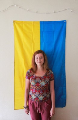 Rublinetska proudly stands in front of her flag. (Photo by Kseniya Sovenko)