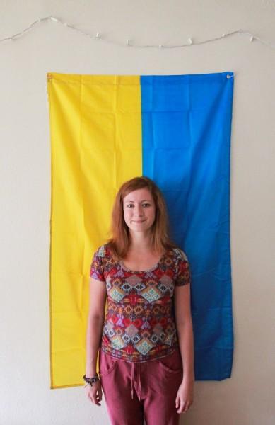 Rublinetska proudly stands in front of her flag. (Photo by Kseniya Sovenko)