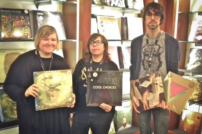 Sub Pop's Sea-Tac gift shop staff picks, from left: Sarah Cass with Dreams in the Rat House by Shannon and the Clams; Rachel Rhymes with Cool Choices by S; Jacob Powers with Bakesale by Sebadoh and Commune by Goat. (Photo by Charlie Zaillian)