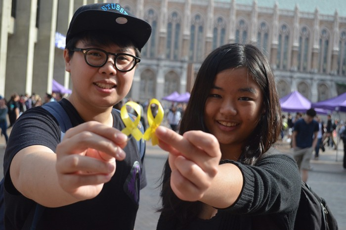 UW students Sophia Lo (Left) and Tina Choi (Right) hold yellow ribbons to show support for the Hong Kong protest. (Photo by Katy Wong)