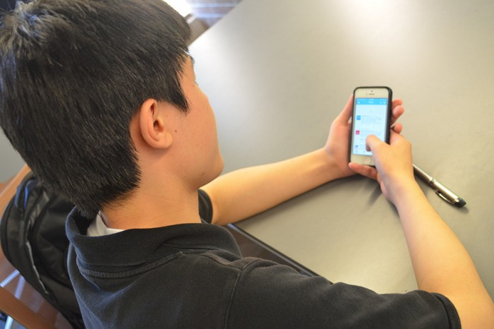 ZeZhou Jing uses Twitter to gain information about the protest in Hong Kong. (Photo by Katy Wong)
