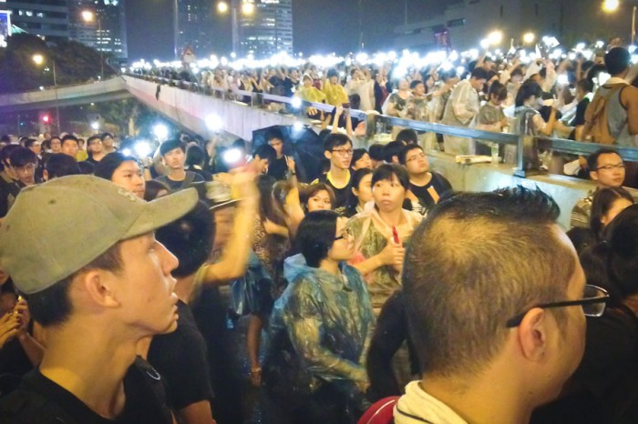 Throngs of young Hongkongers use their cell phones to light up the streets in Admiralty district of Hong Kong last week. (Photo by Yue Ching Yeung)