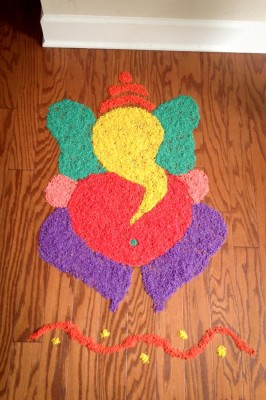 A rangoli depicting Ganesh made by the author. This decorative folk art is made by arranging colored rice, flour, sand and other materials on the floor. (Photo by Ruchika Tulshyan)