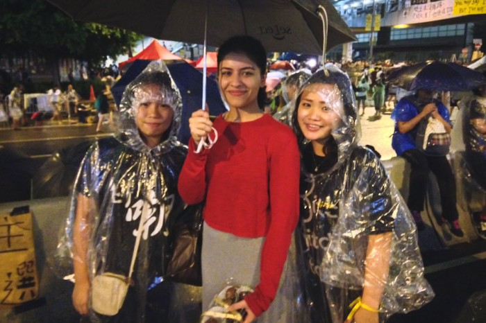 The author (left) with a Pakistani visitor who delivered homemade cake pops to rained out protesters. (Photo by Yue Ching Yeung)