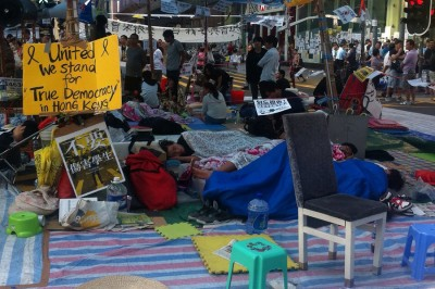 Protesters rest and sleep on Oct 11 on the road in Mong Kok, one of the occupy areas in Hong Kong. (Photo by Tammy Ho)
