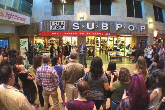 The opening ceremony for Sub Pop's new gift shop at Sea-Tac Airport, back in May. (Photo courtesy Sub Pop)