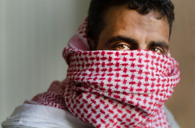 """""""Hamdan,"""" a 36-year-old former FSA fighter who now lives in a Jordanian refugee camp, plans to return to Syria to rejoin rebel ranks this month. (Photo by Alisa Reznick)"""