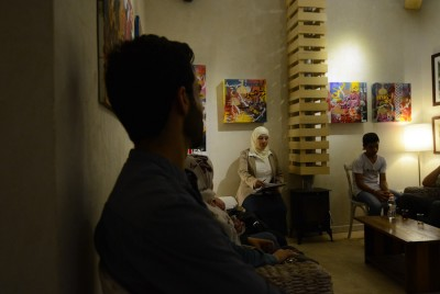 Syrian activists and artists meet for a night of featured poetry about the revolution and the conflict at a cafe in Amman. While the Zaatari camp houses some 85,000 refugees, many Syrians, like Eidmouni, also reside in Jordan's cities. (Photo by Alisa Reznick)