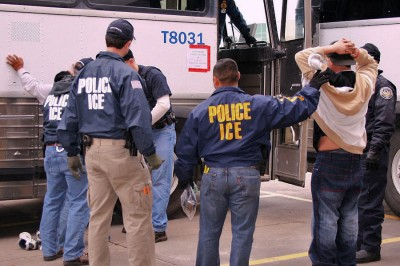 Agents from Immigration and Customs Enforcement arresting suspects during a 2010 raid. More people have been deported under Obama than any previous president. (Photo from ICE)