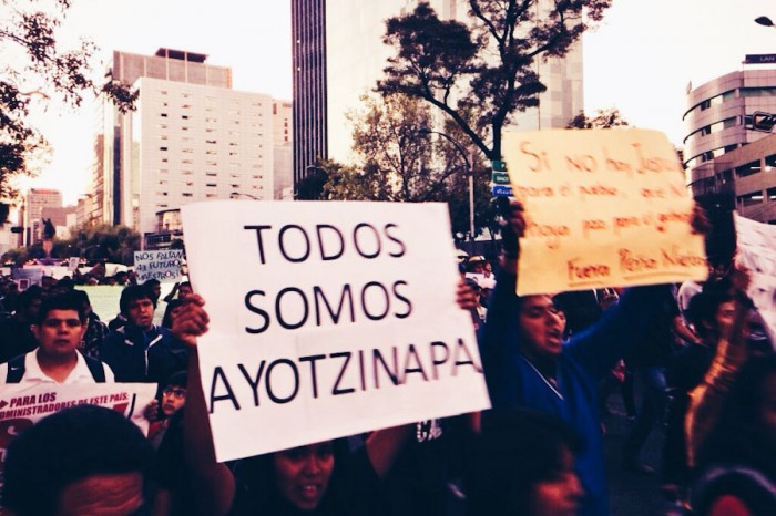 "Protesters in Mexico City last November hold up signs reading ""We are all Ayotzinapa."" (Photo by Gloria Mayne Davó)"