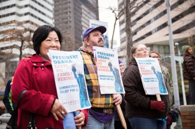Seattleites joined Mayor Murray, Rep. Adam Smith and immigrant rights advocates at a rally outside the Federal Building Thursday, heralding Obama's executive action and demanding further steps toward immigration reform. (Photo by Alex Garland)