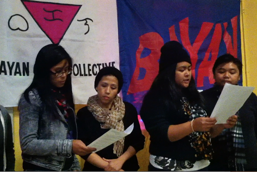From left to right, Laune Torres, Rosie Dino, Elaine and Jill Mangiliman read a letter aloud to Jennifer Laude in mourning, authored by Katrina Pestano.