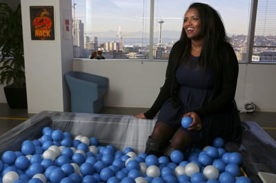 """Selam Zecharias, an intern at Facebook's Seattle office, is interviewed in the office """"hot tub,"""" About one percent of Facebook employees are African-American. (Photo by Ken Lamber / The Seattle Times)"""