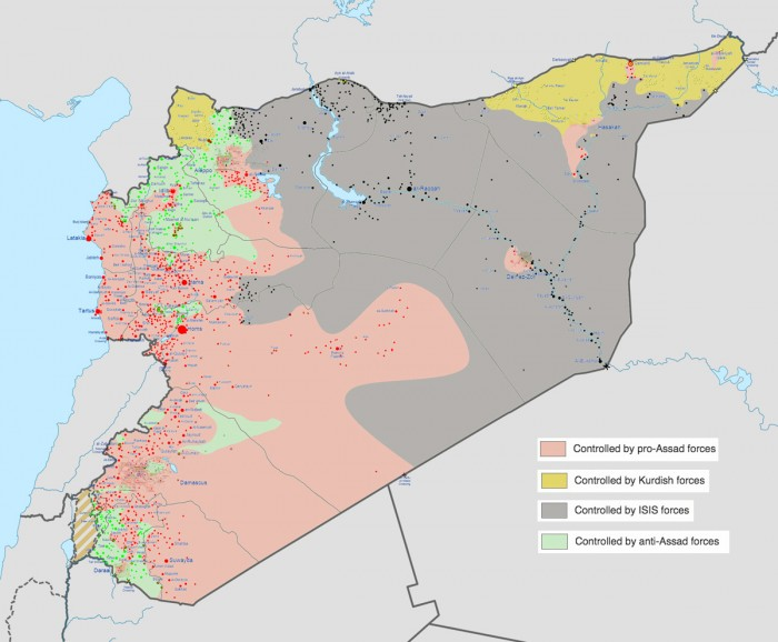 A map of the Syrian Civil War shows Kurdish controlled regions in the north (yellow), ISIS strongholds in Eastern deserts (black), areas still controlled by the Assad regime (red), and pockets of anti-Assad forces like the FSA and Nusra Front (green). (Map from Wikipedia)