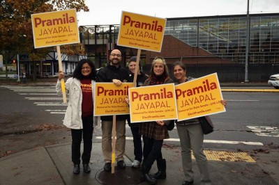 Pramila Jayapal and supportes wave signs at the corner of Martin Luther King, Jr Way and Rainier Ave on Election Day. (Photo courtesy Jayapal for State Senate)