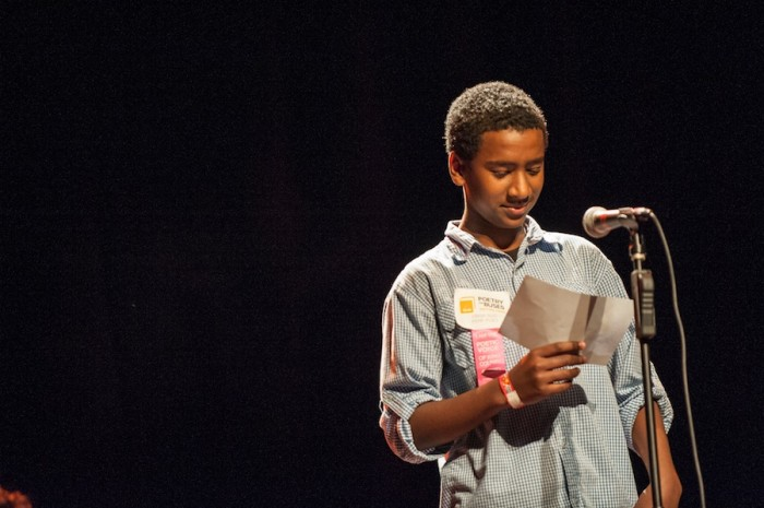 Ethiopian American youth poet Obsa Seid reads at the Poetry on Buses launch Monday night at the Moore Theatre. (Photo by Timothy Aguero)