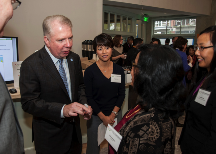 Mayor Ed Murray (right) talks with soon to be restaurant owner, Gita Bangera at the Restaurant Success Initiative launch event. (Photo courtesy Erik Stuhaug)