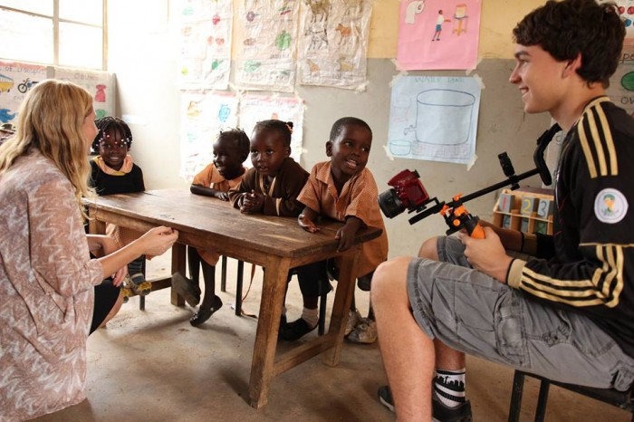 Alder Sherwood and son Josiah Sherwood work with children at the Young Generation Centre in Kisumu, Kenya for the project Africa from the Skies. (Photo courtesy of One Vibe Africa)