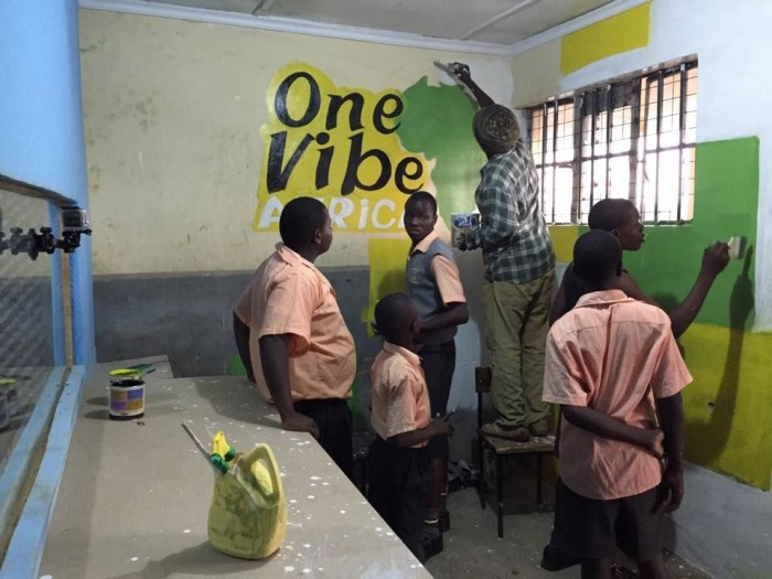 Students at the Young Generation Centre help prepare for the installation of a recording studio. (Photo courtesy of One Vibe Africa)