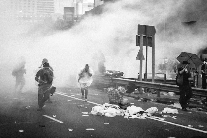 "Hong Kong protesters being tear gassed at a September ""Occupy Central"" demonstration. (Photo by Pasu Au Yeung via Flickr Creative Commons)"