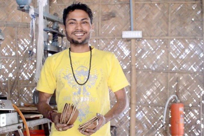 Twenty-two-year-old Tanjit Pathak was originally a leaf washer at the Tamul factory. After six months, he became a machine operator. (Upaya courtesy photo)