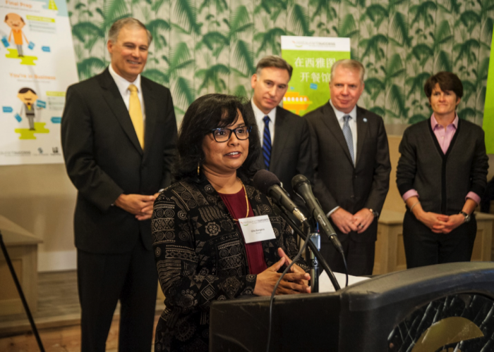 Gita Bangera, who is in the process of opening up her own restaurant, speaks on the triumphs of the past and how the Initiative will streamline the process of starting a restaurant at the launch event of the initiative. (Photo courtesy Eric Stuhaug)