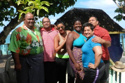 Evita Robinson, center, with Nomadness travelers and their local host in Apia, Samoa. (Photo courtesy Nomadness)