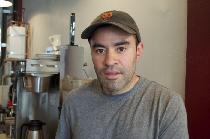 Carlos Salmeron is one of the first cafe owners in Seattle with family heritage in a coffee sourcing country and coffee farming. (Photo by Janelle Retka)