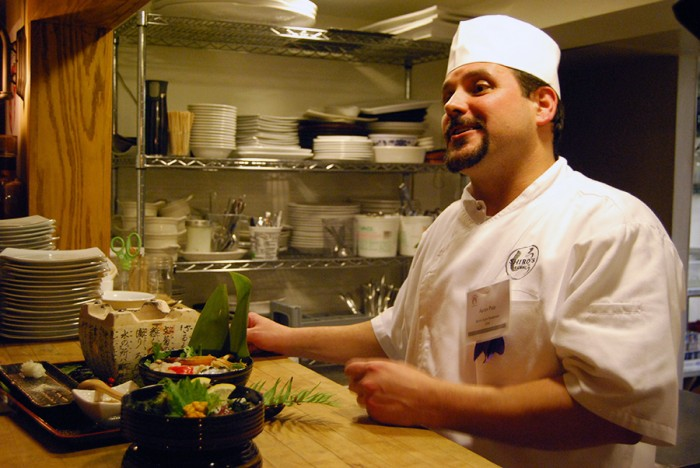 Chef Aaron Pate eagerly talks with guests about his food spread after the competition. (By Ana Sofia Knauf)